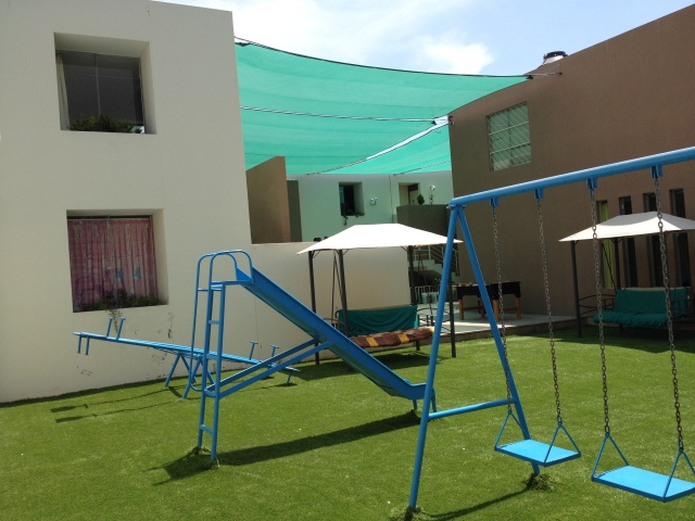 The playground of Casa Isobel, the shelter for girls who have suffered domestic or sexual violence. All of the profit-generating businesses support the shelter.