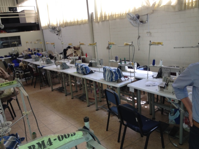 A row of sewing machines in the textile factory