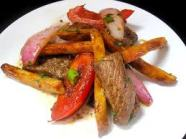 Loma Saltado is beef stir fried with onions and peppers